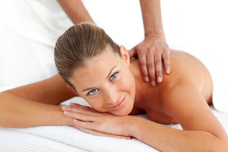 Portrait of  woman having a massage in a spa center