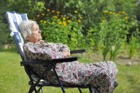 senior lady sleeping in garden