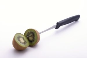 Sliced kiwi knifed at its core